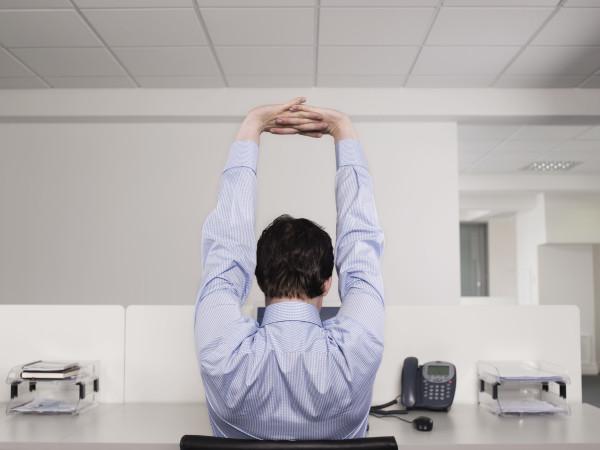 Man Stretching at Desk